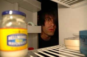 Peering into an empty fridge